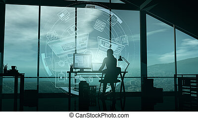 A web developer at a computer in her office and virtual infographics.