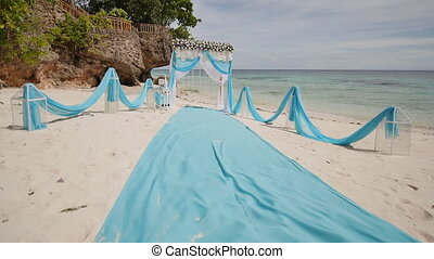 A wedding arch decorated with flowers on a tropical beach. Philippines. Bohol.