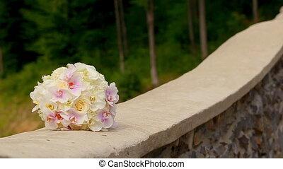 A Wedding Bouquet on a Stone Wall - A wedding bouquet on a...