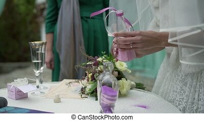 A wedding ceremony with a mixed family. The groom, mother,...