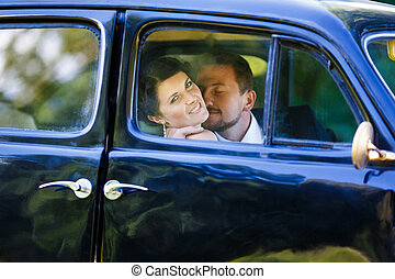 A wedding couple in old car - Embrace happy wedding couple ...