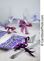 A wedding dining table arrangement with champagne glass