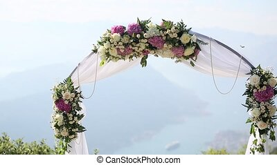 A wedding in the mountains. Wedding arch for the ceremony on...