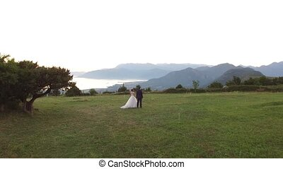 A wedding in the mountains. The wedding ceremony atop Mount...