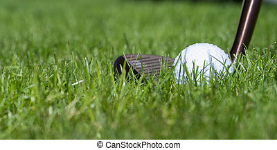 a wedge and a golf ball