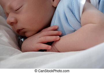 A week old baby sleeping