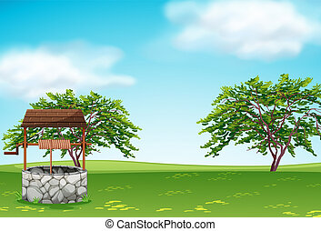 A well in the green landscape