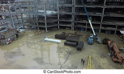 A wet construction site - A vertical inspection of a big...