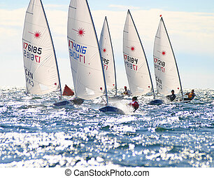 A wet ride - Laser sailors race downwind at the Canadian...