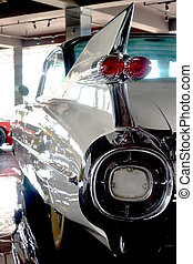 A white 1959 retro car, reflection in the mirrors, vertical photo