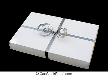 gift wrapped - a white box gift wrapped with a silver ribbon...