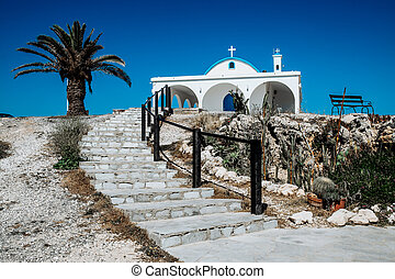 A white chapel on a cliffs of Kavo Greko near Aiya Napa, Cyprus