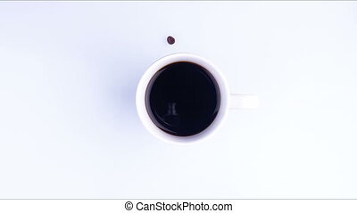 A white cup of coffee on the table