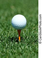 White golf ball on a orange tee