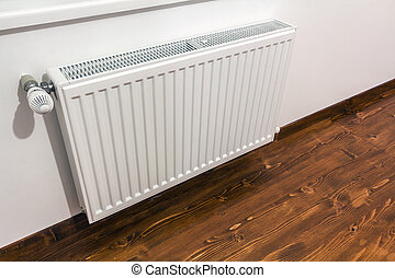 A white heating radiator on the interior wall.