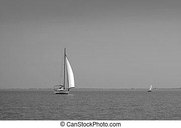 A white sailboat on Lake Balaton
