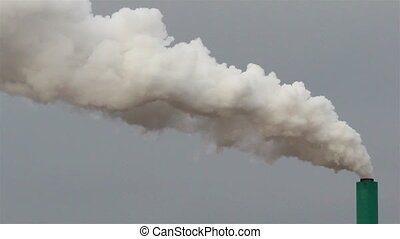 A white smoke coming out from a factory
