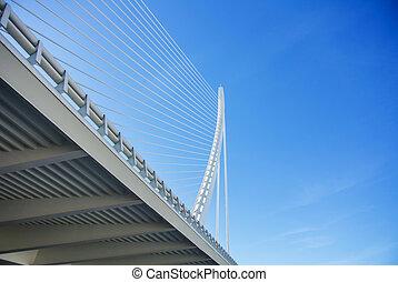 A white suspended bridge at Ciudad de las Artes y las...