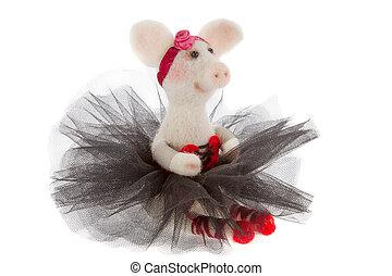 White toy pig in a tutu  - a White toy pig in a tutu