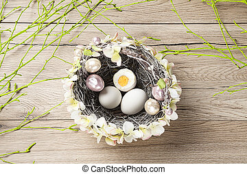 A wicker basket filled with easter eggs