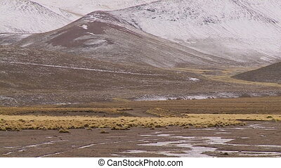 A wide mountain valley range - A sweeping wide shot of a...