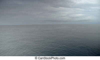 A wide shot of the ocean