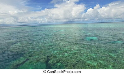 A wide shot of the sea and great barrier reef