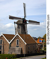 a windmill in the centre of oudeschild, texel