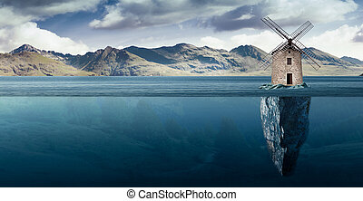 windmill on a small island in the middle of the lake