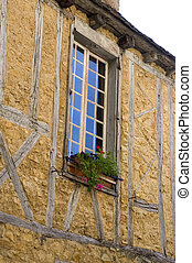 A window of an old building in the center of Sarlat