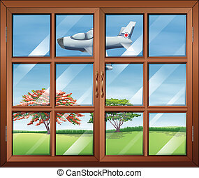 A window with a view of the airplan