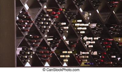 A wine cellar inside in a bar - A steady medium shot of a...