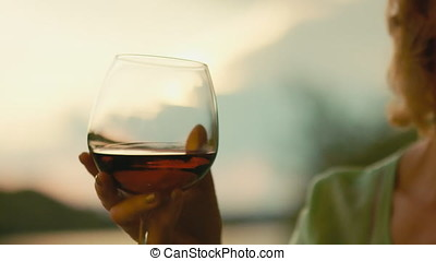 a wine glass in female hand