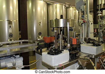 machine - A winery capping and labeling bottle machine