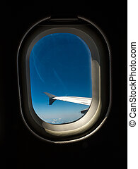 wing of an airliner against blue sky