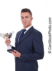 winner with suit holding a cup