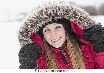 winter portrait of cute pretty young girl