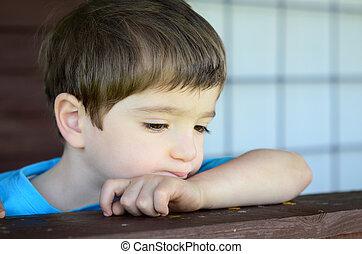 wistful child - a wistful child on his porch