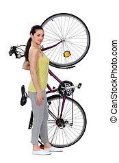 A woman and her big bike.