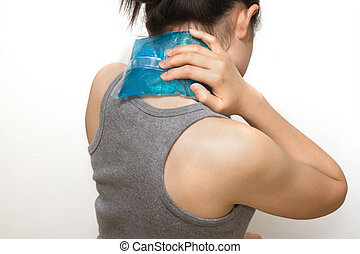 a woman applying cold pack on swollen hurting neck