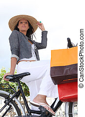 a woman at bike who did some shopping