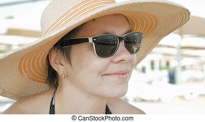 A woman at the beach with fashionable style attire - A woman...