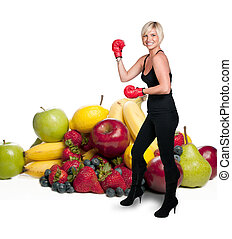 A woman boxer and Assorted Fruits