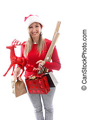 A woman carrying various gifts and decorations for Christmas
