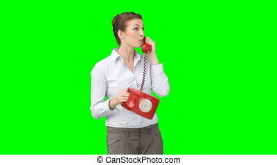 A woman chatting on the telephone