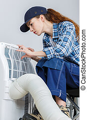 a woman checking the ventilation