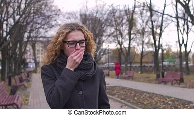 A woman coughs in the street, slow-motion shooting