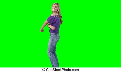 A woman dancing as she turns around