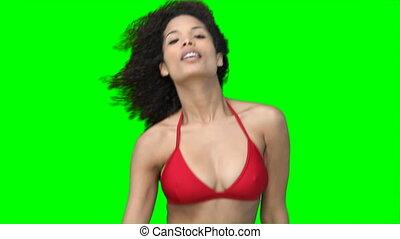 A woman dancing in a bikini