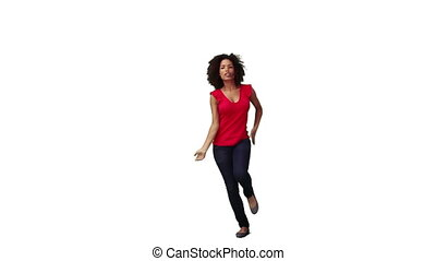 A woman dancing on her own against a white background